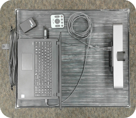 Image of cart style two. The Logitech camera is connected to the laptop via USB. A Samson-brand lapel mic is shown, with its USB receiver connected to the laptop.