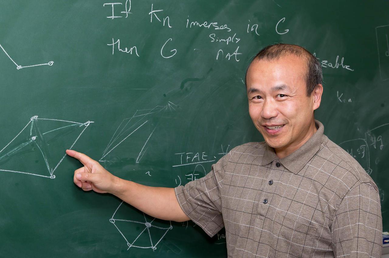 Guoli Ding at the blackboard