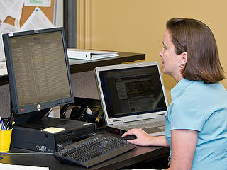 Stephanie Kurtz managing the Math Lab clock
