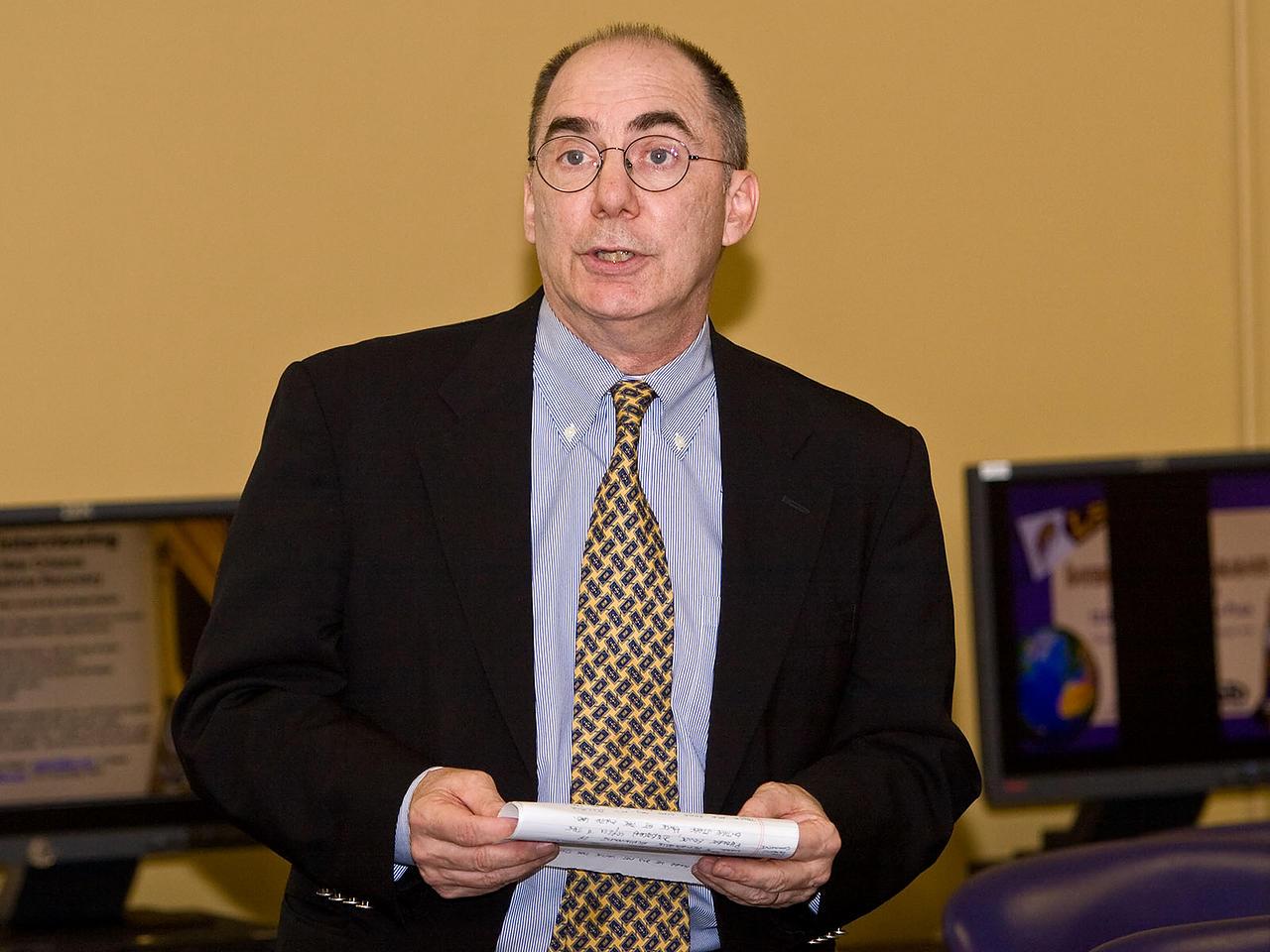 Pearson's President for Mathematics Greg Tobin presents the award