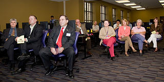 Audience, including Department Chair Lawrence Smolinsky, Dean Guillermo Ferreyra, and Chancellor Michael Martin