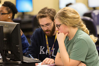 Tutor assisting a student in LSU Math Lab